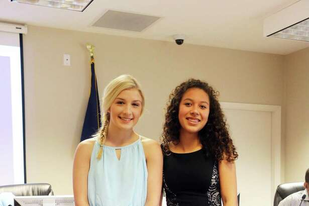 The Dayton Class of 2018 Valedictorian Arely Leyva, right, and Salutatorian Eavin Cormier.