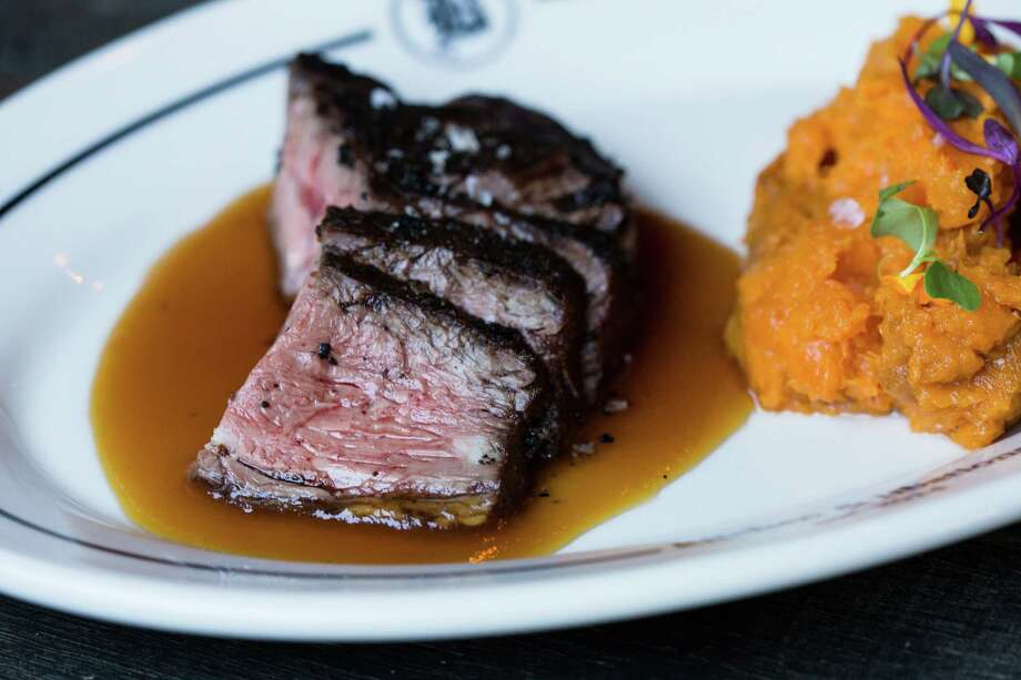 Sugar barrel steak with sweet potato mash and stout and caramelized onion gravy is one of the dozen new dishes added to the menu at Bosscat Kitchen & Libations in River Oaks. Photo: Kristen Gilliam