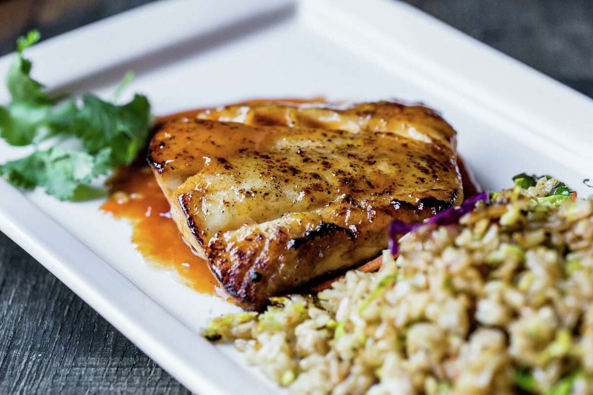 Snapper with rye whiskey butter, shaved vegetables and fried brown rice is one of the dozen new dishes added to the menu at Bosscat Kitchen & Libations in River Oaks.