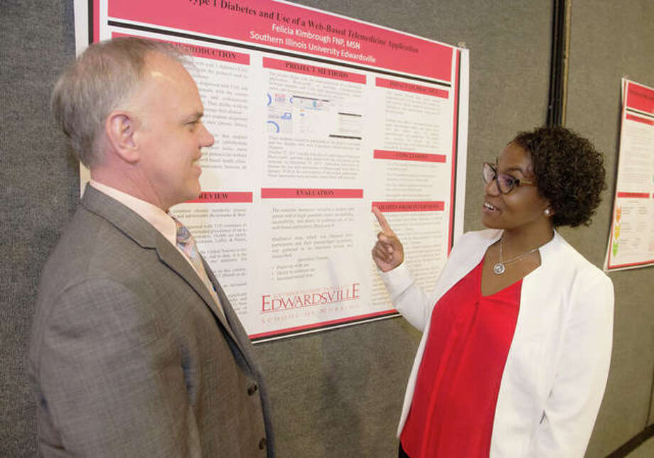 SIUE School of Nursing DNP program graduate Felicia Kimbrough presents her practice project to Assistant Dean for Graduate Programs Andrew Griffin. Photo:       For The Telegraph