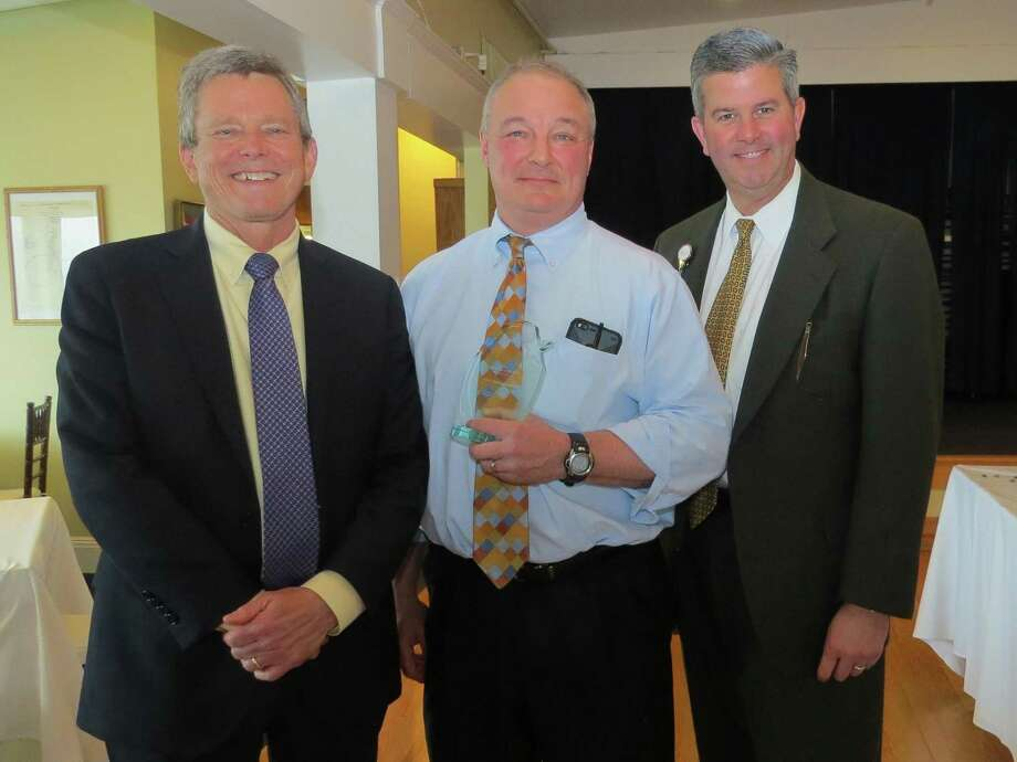 Dr. Michael Ivy, Bridgeport Hospital chief medical officer; Dr. David Bindelglass, the hospital's Physician of the Year; and William M. Jennings, hospital president and CEO Photo: Contributed / Bridgeport Hospital