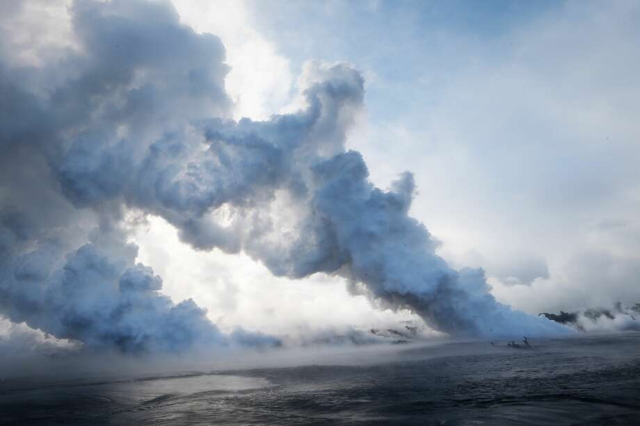 Steam plumes rise as lava enters the Pacific Ocean, after flowing to the water from a Kilauea volcano fissure, on Hawaii's Big Island on May 20, 2018 near Pahoa, Hawaii. Officials are concerned that 'laze', a dangerous product produced when hot lava hits cool ocean water, will affect residents. Laze, a word combination of lava and haze, contains hydrochloric acid steam along with volcanic glass particles. Photo: Mario Tama/Getty Images