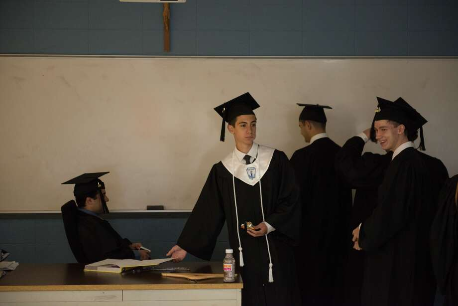One hundred and fifty nine young men marched into Xavier High School in  Middletown as undergraduates and left as alumnus after the school's 52nd  annual commencement exercises Sunday. Photo: Kevin Scotton