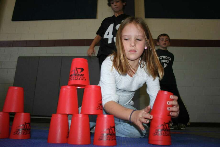 Are you the best cup stacker in the world? An elementary student participates in helping to break the world record in cup stacking for the most number of stackers at one time in 2017. The San Antonio Express-News is looking for people who've reached the pinnacle of their chosen area of expertise. Photo: File Photo / Hearst Media / The Potpourri