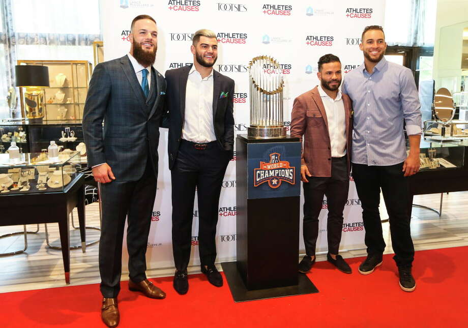 "Hosts Houston Astros players Dallas Keuchel, from left, Lance McCullers Jr. and Jose Altuve pose for a photograph with teammate George Springer at ""Team Up for Kids and K9s"" benefitting various charitable causes that  are passionate about on Thursday, May 17, 2018, in Houston. Benefitting organizations included animal rescue efforts, children's charities, and other initiatives throughut the Greater Houston community. Photo: Yi-Chin Lee, Houston Chronicle / © 2018 Houston Chronicle"