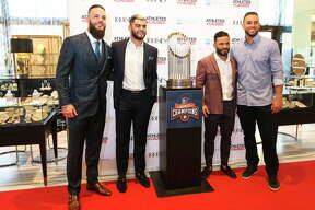 """Hosts Houston Astros players Dallas Keuchel, from left, Lance McCullers Jr. and Jose Altuve pose for a photograph with teammate George Springer at """"Team Up for Kids and K9s"""" benefitting various charitable causes that  are passionate about on Thursday, May 17, 2018, in Houston. Benefitting organizations included animal rescue efforts, children's charities, and other initiatives throughut the Greater Houston community."""