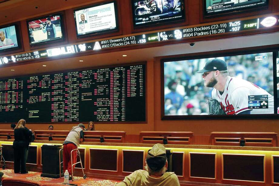 In this Monday, May 14, 2018 file photo, people make bets in the sports book area of the South Point Hotel and Casino in Las Vegas. Those who deal with compulsive gambling are worried that a rapid expansion of sports betting in the U.S. could cause more people to develop gambling problems. The U.S. Supreme Court on Monday cleared the way for states to legalize sports betting. Photo: John Locher /Associated Press / Copyright 2018 The Associated Press. All rights reserved.