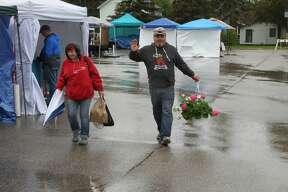 A little rain didn't stop shoppers from checking out the first weekend of the Port Austin Farmers Market on Saturday. The market brings in 150 vendors and thousands of visitors each Saturday through Oct. 13.