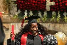 Graduate Diandre Clarke, of Bridgeport, celebrates after receiving her diploma at the Fairfield University commencement in Fairfield Sunday. Officials said later that nearly 10,000 people attended as the Jesuit university awarded 990 bachelor's degrees, 385 master's degrees, 15 sixth-year certificates and 39 doctorates.