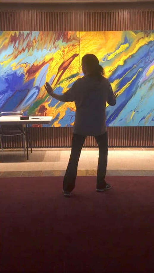 Tai Chi Instructor Margie Sinclair-Parish practices the Chinese martial art in the Hatheway Lobby at L&C. Photo:       For The Telegraph