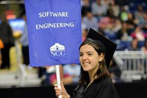 Norwalk Early College Academy graduate Erin Aymerich celebrates during Norwalk Community College's 56th annual graduation Thursday May 17, 2018, at its new off-campus location, the Webster Bank Arena in Bridgeport, Conn.