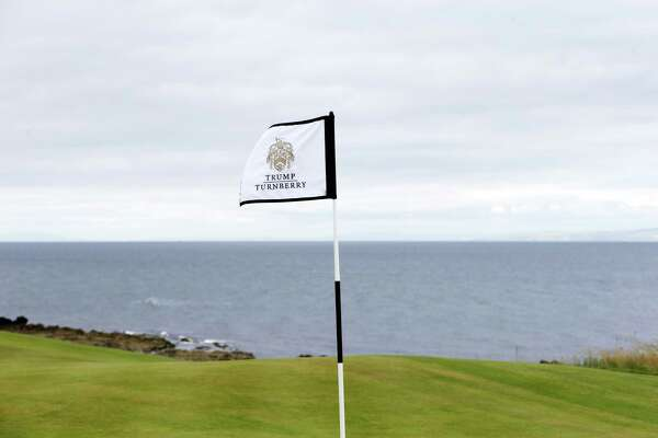 The Trump Turnberry logo sits on a flag during the grand opening of The King Robert The Bruce Golf Course at Trump Turnberry golf resort, owned by The Trump Organisation Inc., in Turnberry, U.K., on Wednesday, June 28, 2017.