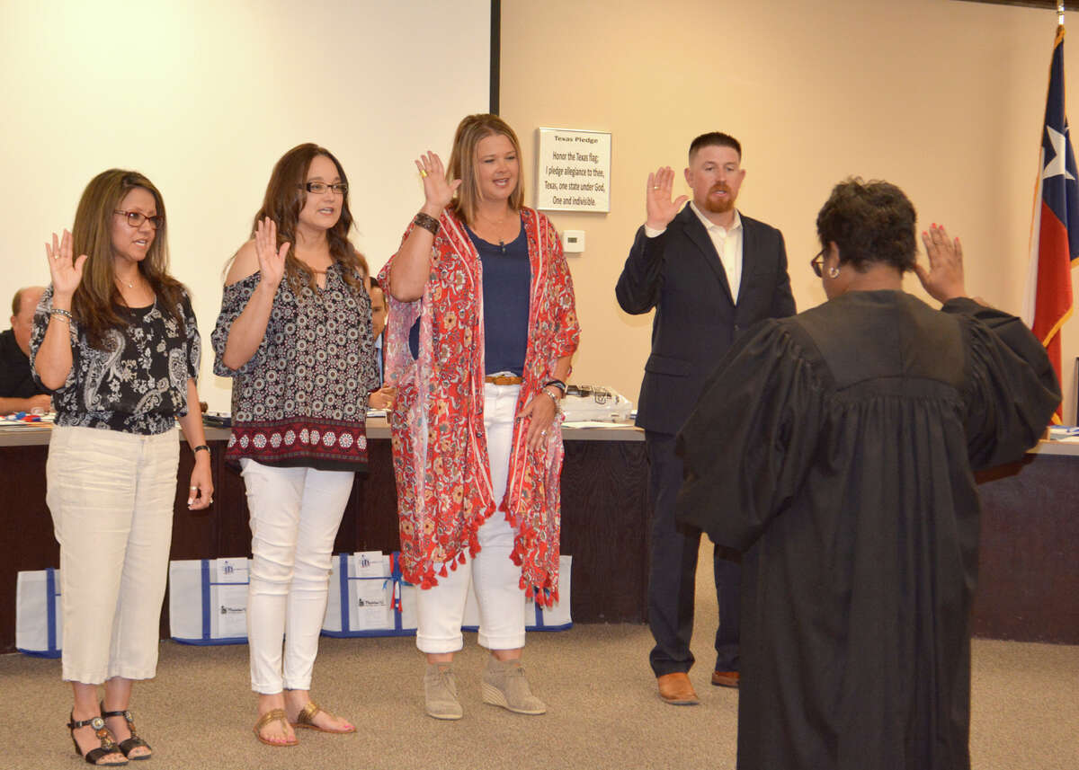 Precinct 1 Justice of the Peace Sheron Collins administers the oath of office to new Plainview ISD trustees JoAnn Rey (left), Sofia Rivera, Amber Bass and Tyler James at Thursday's School Board meeting. Rey, in Precinct 5, replaces Ron Warren; Rivera, Precinct 2, Robert Rivera; Bass, Precinct 4, Brandon Brownlee; and James, Precinct 3, Bryan Wood. None of the incumbents sought re-election.