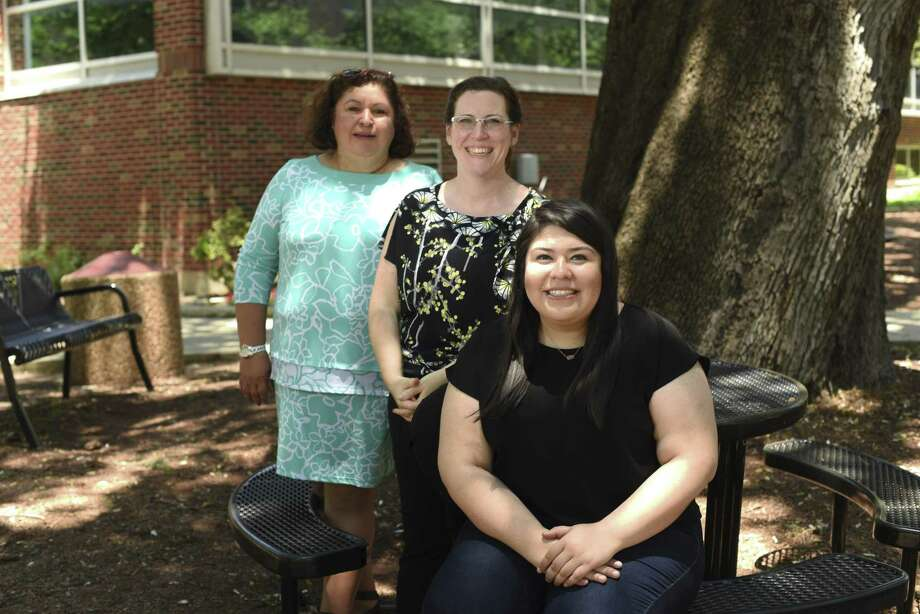 UIW assistant professor Ann David, middle, created an online bilingual curriculum for the National Catholic Sisters Project. She is accompanied by editor and curriculum writer Elizabeth Ortiz, left, and Alejandra Herrera, right, editor and translator. They sit for a picture on campus on Wednesday, May 16, 2018. Photo: Billy Calzada, Staff / San Antonio Express-News / San Antonio Express-News