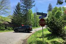 Southbury Police block Purchase Brook Road where authorities say a suspect is armed and refusing to leave. The armed stand-off began around 2 a.m. Monday, May 21,2018 after officers responded to reports a disturbance at the home. The suspect is believed to have a firearm, police said, and is refusing to leave the house.