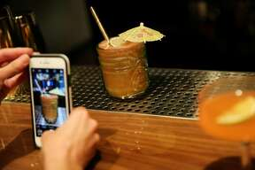 Customers take a photo of the Quimbara at The Beehive, Saturday, May 5, 2018, in San Francisco, Calif. The Beehive is located at 842 Valencia Street.
