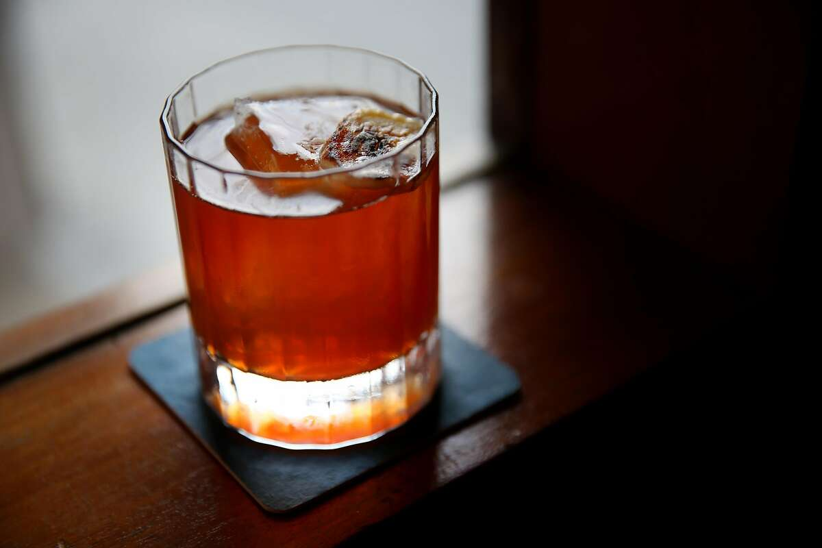 The Hound Dog cocktail is a nod to Elvis Presley with toasted peanut oil-infused Bulleit bourbon, Sherry and caramelized banana liqueur. It's the classiest peanut butter-banana sandwich you'll ever drink.