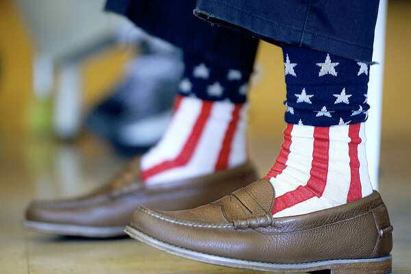 Rev. Guy Camp wears American flag socks while working the polls at Grace United Church of Christ in Greencastle, Pa., Tuesday, May 15, 2018, during the Pennsylvania primary election. (Colleen McGrath /The Herald-Mail via AP)