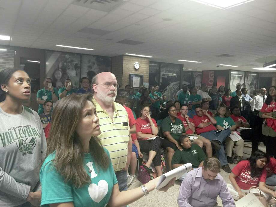 Hundreds of anxious parents and residents watch as Fort Bend ISD trustees discuss long-term plans for the district's schools and facilities in an overflow area outside the full-to-capacity board room. Many more were turned away at the door by police after the lobby area became too full to navigate safety on Monday, May 14. Photo: Kristi Nix