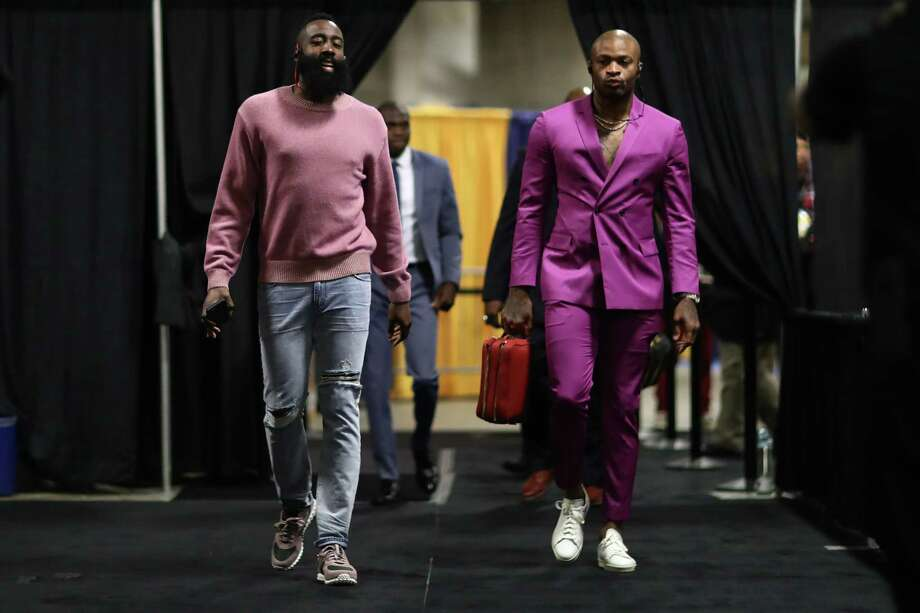 NBA FASHION: Houston Rockets v Golden State Warriors - Game ThreeOAKLAND, CA - MAY 20: James Harden #13 and PJ Tucker #4 of the Houston Rockets arrive for Game Three of the Western Conference Finals of the 2018 NBA Playoffs against the Golden State Warriors at ORACLE Arena on May 20, 2018 in Oakland, California. Photo: (Photo By Ezra Shaw/Getty Images) / 2018 Getty Images