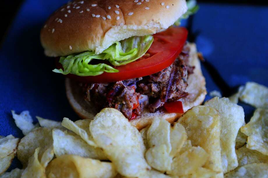 Venison has a lean, gamey texture, but makes a great burger with the help of a little garlic and chopped bacon. Photo: John Davenport /San Antonio Express-News / ©John Davenport/San Antonio Express-News
