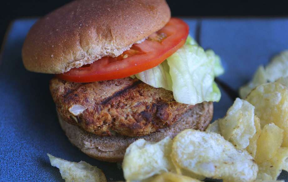 For a lighter burger option, the package or two of tuna sitting in the pantry can be easily formed into a thick patty mixture that's ready for the grill in minutes. Photo: John Davenport /San Antonio Express-News / ©John Davenport/San Antonio Express-News