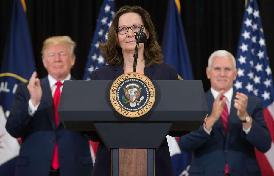 Gina Haspel (C) speaks after being sworn in as the Director of the Central Intelligence Agency alongside US President Donald Trump (L) and US Vice President Mike Pence (R) during a ceremony at CIA Headquarters in Langley, Virginia, May 21, 2018. / AFP PHOTO / SAUL LOEBSAUL LOEB/AFP/Getty Images Photo: SAUL LOEB, AFP/Getty Images