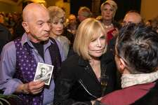 """Kim Novak surrounded by fans and guests at an event in her honor """"A Tribute to living Legend Kim Novak"""" at the Castro Theater on Sunday, May 20, 2018. San Francisco Calif. Alex Gildzen standing next to Novak holds signed photograph of her, which she sent to him about 60 years ago. When Alex Gildzen sent Novak a """"get well"""" card when she was in the hospital, she responded by sending him this signed photograph."""