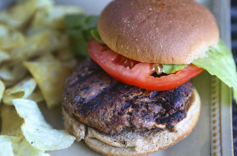 Black beans that are dried, ground in a food processor and mixed with flour, breadcrumbs and cheddar cheese make for an easy veggie burger that takes well to the grill. Photo: John Davenport /San Antonio Express-News / ©John Davenport/San Antonio Express-News
