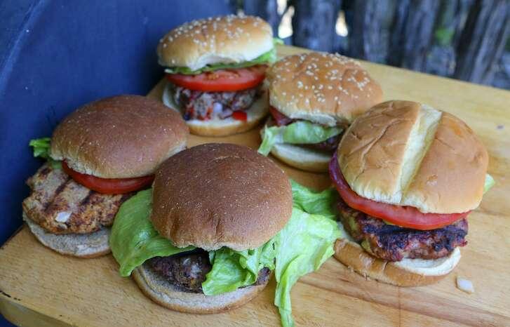 San Antonio Express-News writer Chuck Blount prepares burgers with alternative meats such as wild boar, tuna, venison, goat and a vegetarian black bean mixture.