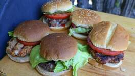 San Antonio Express-News writer Chuck Blount prepares burgers with alternative meats such as wild boar, tuna, venison, goat and a vegetarian black bean mixture.