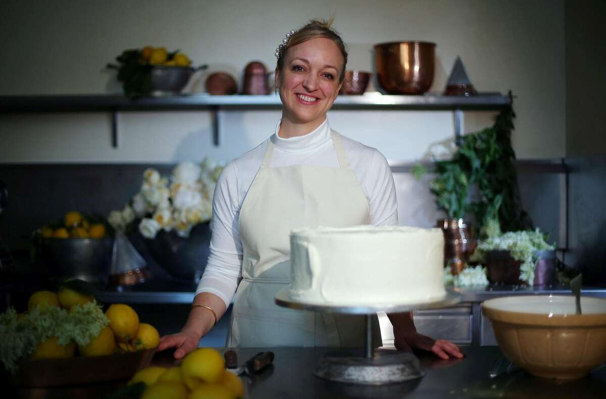 LONDON, ENGLAND - MAY 17: (ONLINE OUT) Claire Ptak, Owner of Violet Bakery in Hackney, east London puts finishing touches on the cake for the Royal Wedding of Prince Harry and Meghan Markle in the kitchens at Buckingham Palace on May 17, 2018 in London England. (Photo by Hannah McKay - WPA Pool /Geetty Images)