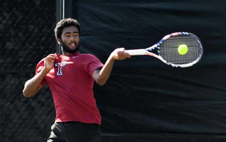 Katy Tompkins High School senior Anish Sriniketh plays a shot against Pearland Dawson senior Kevin Zhu during their Class 6A Boys Singles Finals match against  at the 2017-2018 UIL State Tennis Championships at the George P. Mitchell Tennis Center on the campus of Texas A&M University in College Station on May 18, 2018. Photo: Jerry Baker, For The Chronicle / Freelance