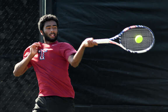 Katy Tompkins High School senior Anish Sriniketh plays a shot against Pearland Dawson senior Kevin Zhu during their Class 6A Boys Singles Finals match against  at the 2017-2018 UIL State Tennis Championships at the George P. Mitchell Tennis Center on the campus of Texas A&M University in College Station on May 18, 2018.