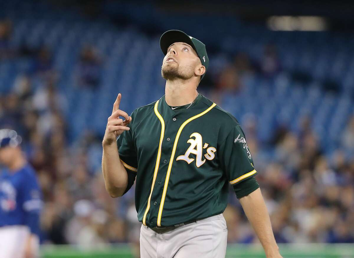 TORONTO, ON - MAY 18: Blake Treinen #39 of the Oakland Athletics reacts after getting the final out of the eighth inning during MLB game action against the Toronto Blue Jays at Rogers Centre on May 18, 2018 in Toronto, Canada. (Photo by Tom Szczerbowski/Getty Images)