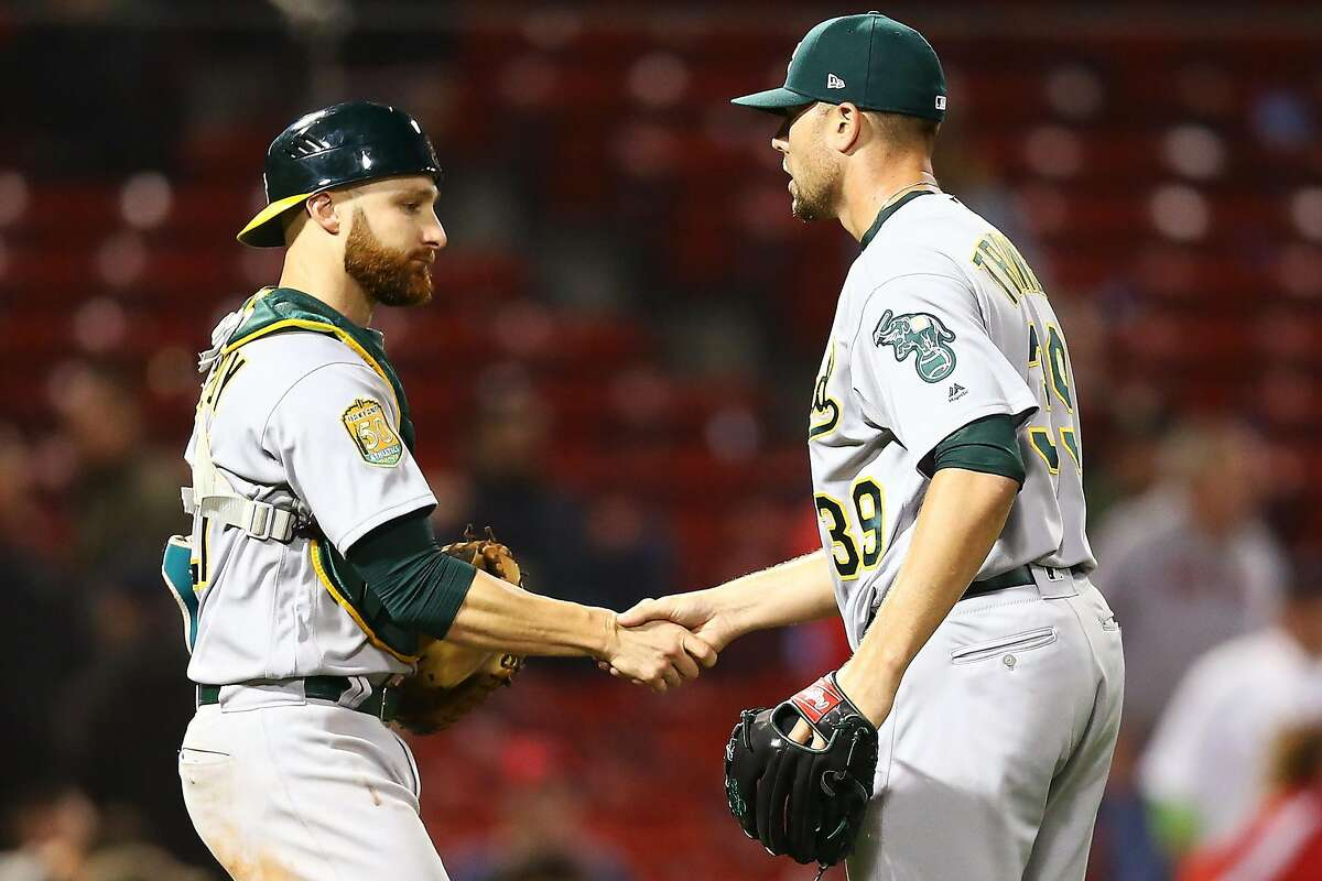 BOSTON, MA - MAY 15: Blake Treinen #39 and Jonathan Lucroy #21 of the Oakland Athletics shake hands after a victory over the Boston Red Sox at Fenway Park on May 15, 2018 in Boston, Massachusetts. (Photo by Adam Glanzman/Getty Images)