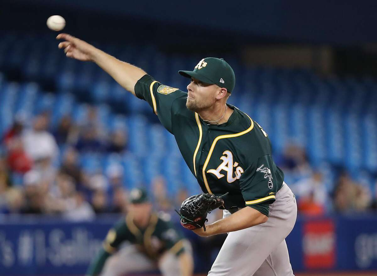 TORONTO, ON - MAY 18: Blake Treinen #39 of the Oakland Athletics delivers a pitch in the ninth inning during MLB game action against the Toronto Blue Jays at Rogers Centre on May 18, 2018 in Toronto, Canada. (Photo by Tom Szczerbowski/Getty Images)