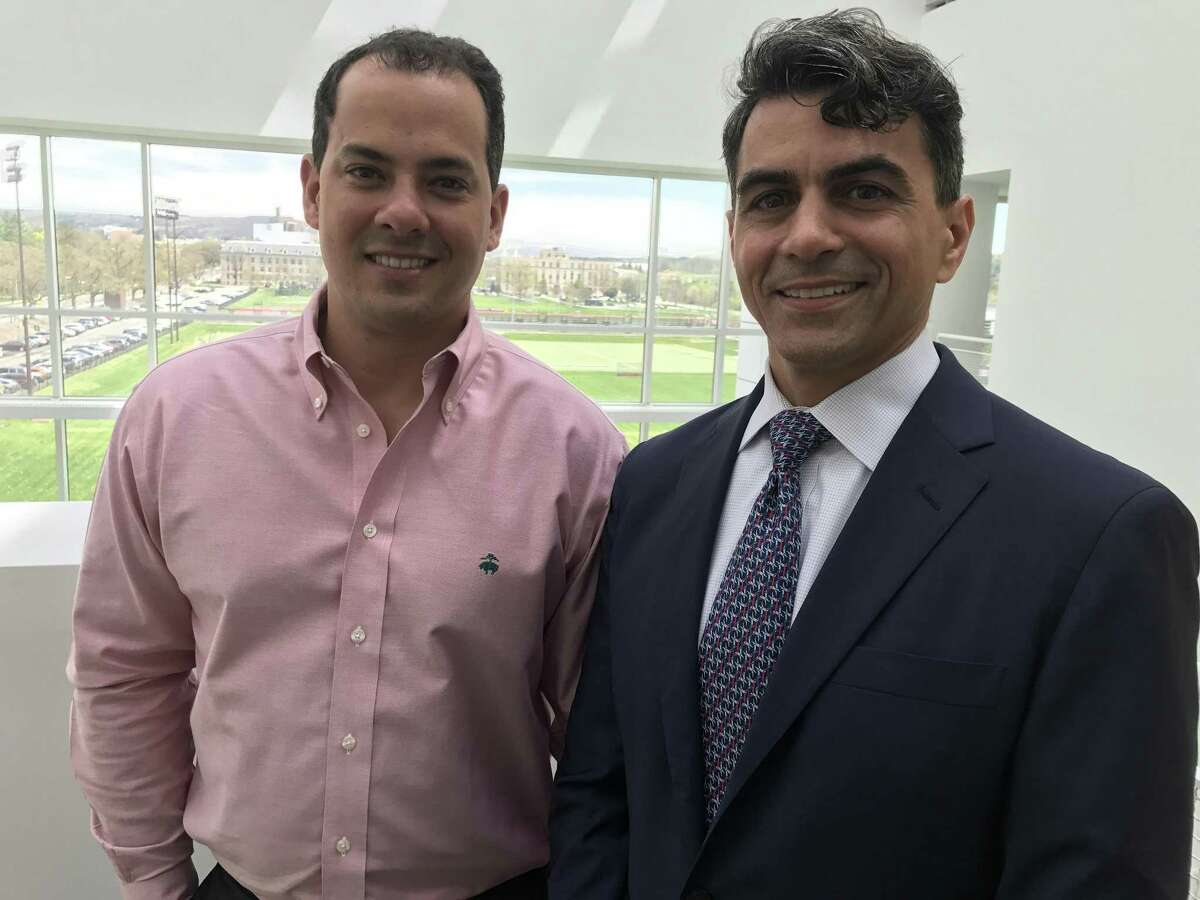 Bactana CEO John Kallassy, right, with the company's chief scientific officer Rodrigo Bicalho at Cornell University, where Bicalho is a professor and expert in dairy science.