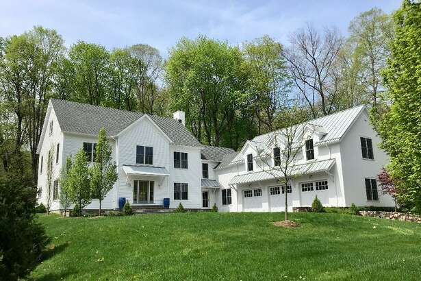 The colonial farmhouse at 311 Mill Road sits on a knoll looking over the Silvermine River just steps away from the historic GrayBarns Inn and Tavern.