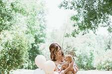 """Texas woman, Joy Stone went viral after doing an adorable """"announcement""""-style shoot for her new puppy."""