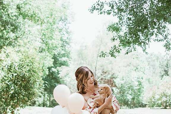 "Texas woman, Joy Stone went viral after doing an adorable ""announcement""-style shoot for her new puppy."