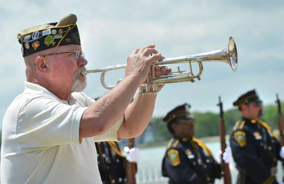 Veteran Buddy Scudder plays taps on the trumpet during the Shea-Macgrath Memorial & Veterans Hall of Honor/Restoration Ceremony at Calf Pasture Beach on Sunday in Norwalk. The city's Veterans Memorial Committee honored Medal of Honor recipients Daniel Shea and John Magrath with a concert and ceremony at the newly refurbished plaques honoring Norwalk's fallen veterans. Photo: Alex Von Kleydorff / Hearst Connecticut Media / Norwalk Hour