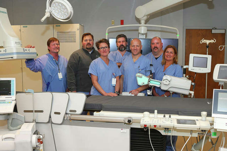 Alton Memorial's Heart & Vascular Center staff with the new equipment in the cath lab. Photo:       For The Telegraph