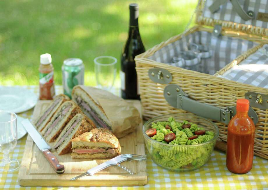 Improve your Memorial Day picnic with a few handy tips. Photo: Paul Stephen, San Antonio Express-News