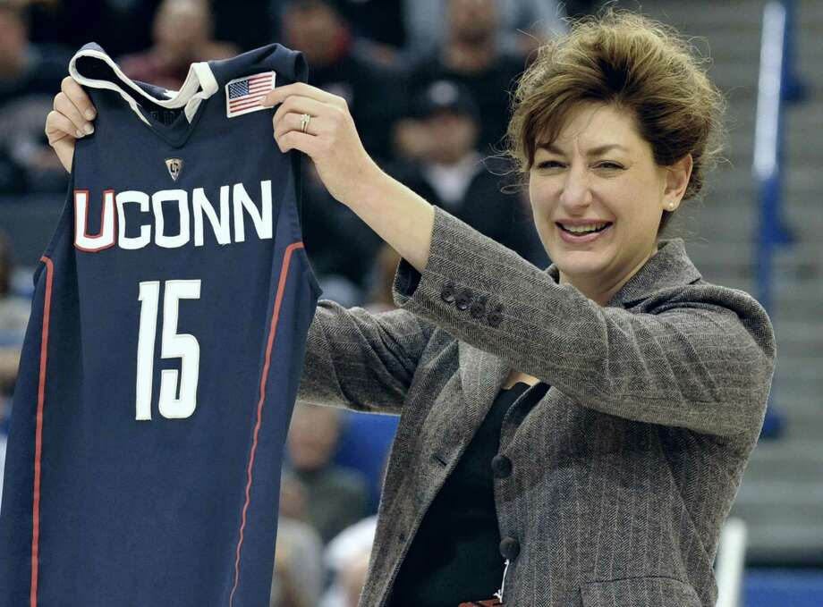 Susan Herbst, newly named 15th president of the University of Connecticut holds up a Connecticut jersey during an NCAA basketball game in Hartford, Conn., Monday, Dec. 20, 2010. Photo: Jessica Hill / AP File Photo / AP2010