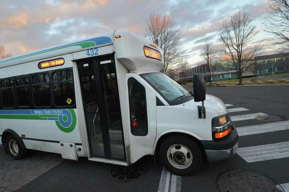A Norwalk Transit District Shuttle in January 2017 in Norwalk, Conn. Under a pilot program with Ford Motor, the city of Norwalk plans to test an Uber-like app that would allow bus drivers to receive alerts that riders are ready to be picked up. Photo: Alex Von Kleydorff / Hearst Connecticut Media / Connecticut Post