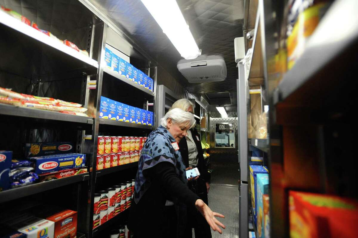 Person-to-Person executive director Ceci Maher leads a tour of the agency's Mobile Food Pantry during the launch party on Fairfield Avenue in Stamford last month.