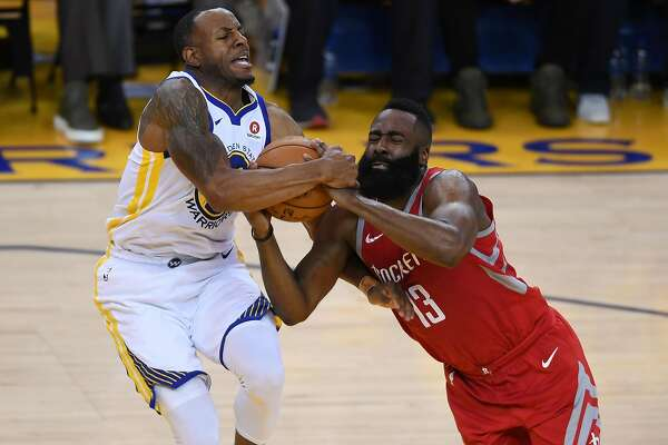 OAKLAND, CA - MAY 20:  Andre Iguodala #9 of the Golden State Warriors and fights for possesion with James Harden #13 of the Houston Rockets during Game Three of the Western Conference Finals of the 2018 NBA Playoffs at ORACLE Arena on May 20, 2018 in Oakland, California. NOTE TO USER: User expressly acknowledges and agrees that, by downloading and or using this photograph, User is consenting to the terms and conditions of the Getty Images License Agreement.  (Photo by Thearon W. Henderson/Getty Images)