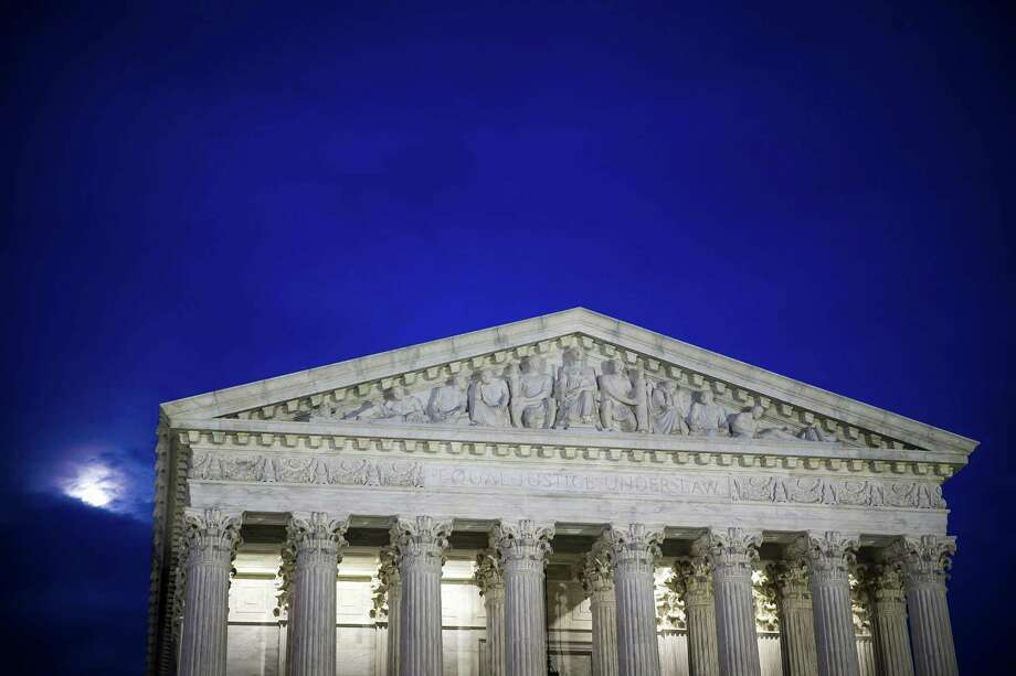FILE-- The U.S. Supreme Court building at dusk, in Washington, Feb. 28, 2018. The Supreme Court on May 21, 2018, ruled that companies can use arbitration clauses in employment contracts to prohibit workers from banding together to take legal action over workplace issues. The vote was 5 to 4, with the courts more conservative justices in the majority. The courts decision could affect some 25 million  (Al Drago/The New York Times) Photo: AL DRAGO /NYT / NYTNS