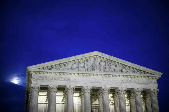 FILE-- The U.S. Supreme Court building at dusk, in Washington, Feb. 28, 2018. The Supreme Court on May 21, 2018, ruled that companies can use arbitration clauses in employment contracts to prohibit workers from banding together to take legal action over workplace issues. The vote was 5 to 4, with the courts more conservative justices in the majority. The courts decision could affect some 25 million  (Al Drago/The New York Times)